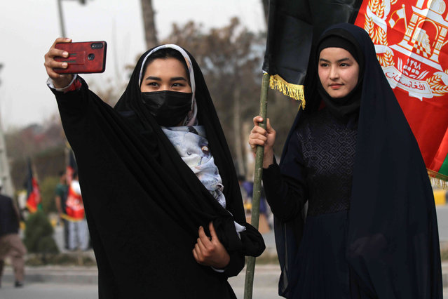 Afghan women attend a rally to support Afghan security forces and demand peace in the country in Herat, Afghanistan, 08 February 2021. Hamdullah Mohib, Afghanistan's National Security Advisor told a press conference in Kabul on 06 February, the Afghan government was ready for war after successive setbacks in recent weeks to peace talks with the Taliban, who have refused to return to discussions that began in September in Doha. (Photo by Jalil Rezayee/EPA/EFE)