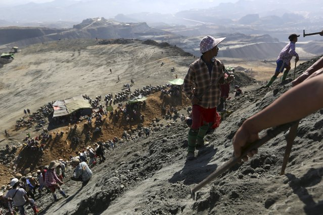 Miners search for jade stones at a mine dump at a Hpakant jade mine in Kachin state, Myanmar November 25, 2015. (Photo by Soe Zeya Tun/Reuters)