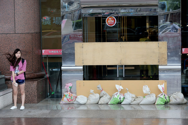 Sand bags to prevent flooding are placed at the entrance of a building in Taipei as Taiwan braced for super typhoon Maria on July 10, 2018. (Photo by Eason Lam/Reuters)