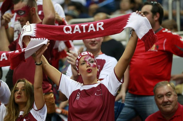 A fan of Qatar cheers before their semi-final match against Poland at the 24th Men's Handball World Championship in Doha January 30, 2015. (Photo by Mohammed Dabbous/Reuters)