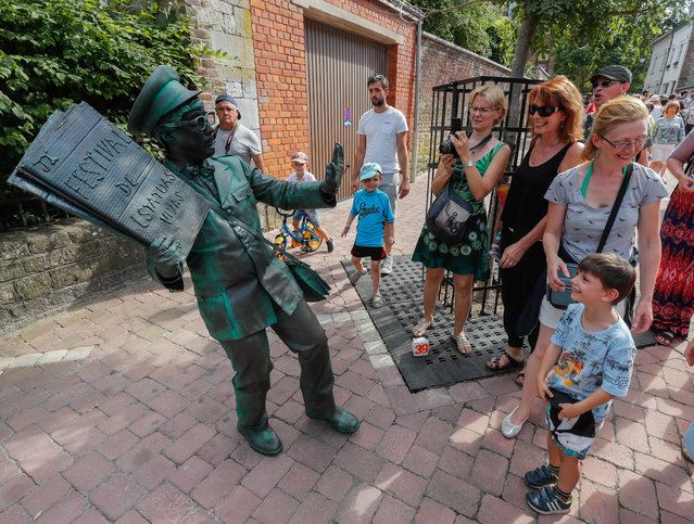 "An artist called ""Le Facteur/The Postman"" takes part in the festival ""Statues en Marche"" in Marche-en-Famenne, Belgium, July 22, 2018. (Photo by Yves Herman/Reuters)"