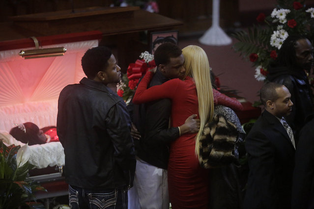 LaTisha Jones (blonde hair) receives a hug as she attends the funeral for her mother Bettie Jones at New Mount Pilgrim Missionary Baptist Church January 6, 2016 in Chicago, Illinois. Bettie Jones, 55 and Quintonio LeGrier, 19 were both killed last month during a police involved shooting where officers were responding to a domestic dispute call after LeGrier pulled a bat on his father. Police later issued a statement saying Jones was accidentally killed. (Photo by Joshua Lott/Getty Images)