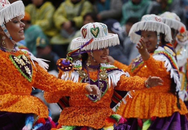 Kullagua dancers perform during the carnival celebrations in Oruro, Bolivia, Saturday February 14, 2015. (Photo by Juan Karita/AP Photo)