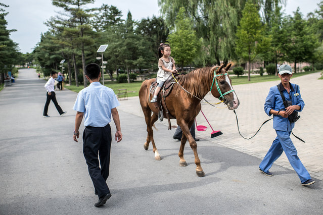 A little girl is given a horse ride in Pyongyang Central Zoo on August 19, 2018 in Pyongyang, North Korea. (Photo by Carl Court/Getty Images)