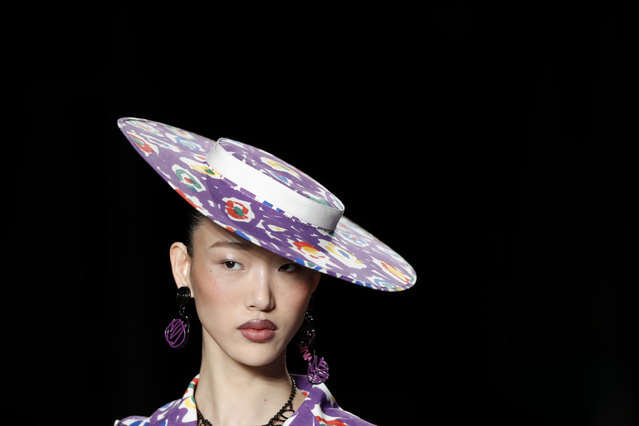 A model wears a creation as part of the Moschino women's 2019 Spring-Summer collection, unveiled during the Fashion Week in Milan, Italy, Thursday, September 20, 2018. (Photo by Antonio Calanni/AP Photo)
