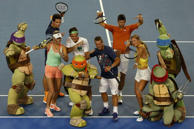 Denmark's Caroline Wozniacki (L-R), Canada's Milos Raonic, Switzerland's Roger Federer, Australia's Lleyton Hewitt, Serbia's Novak Djokovic and Belarus' Victoria Azarenka pose with characters from Teenage Mutant Ninja Turtles during Kids Tennis Day at Melbourne Park, Australia, January 16, 2016. The Australian Open tennis tournament starts January 18. (Photo by Issei Kato/Reuters)