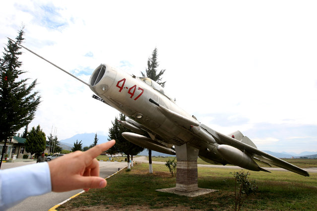 A MiG-19 jet fighter is pictured in Kucova Air Base in Kucova, Albania on October 3, 2018. (Photo by Florion Goga/Reuters)