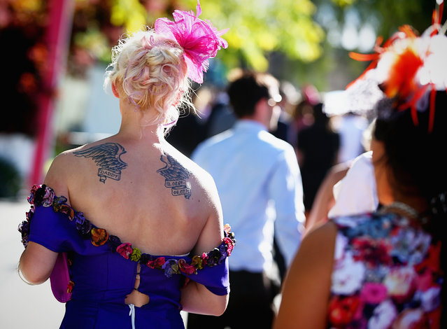 Race goers enjoy the atmosphere at the end of the day at the Melbourne Cup at Flemington Racecourse in Melbourne, Tuesday, November 5, 2013. (Photo by Hamish Blair/AAP/Press Association Images)