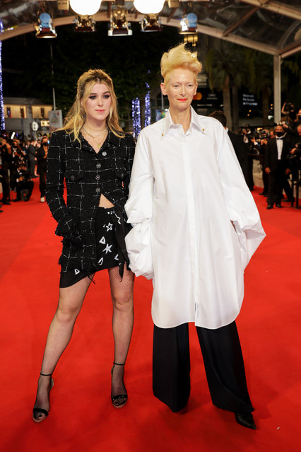 """Honor Swinton Byrne and Tilda Swinton attend the """"Les Olympiades (Paris 13th District)"""" screening during the 74th annual Cannes Film Festival on July 14, 2021 in Cannes, France. (Photo by Stephane Cardinale – Corbis/Corbis via Getty Images)"""
