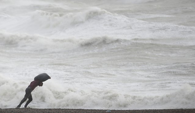 A man leans into the wind on the beach at Newhaven, southern England, February 8, 2015. Winter storm Imogen has brought rough seas and gale force winds to many coastal areas of Britain. (Photo by Peter Nicholls/Reuters)