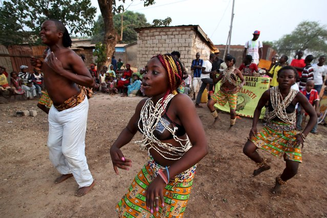 A crowd watches traditional dancers during a campaign in support of Faustin-Archange Touadera, who will be running against Anicet-Georges Dologuele in Sunday's second round of presidential elections, in the capital Bangui, Central African Republic, February 9, 2016. (Photo by Siegfried Modola/Reuters)