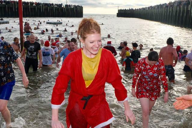 Hundreds of swimmers, many in fancy dress, turn out on Boxing Day to take part in the annual West Bay Wallow on Dorset's Jurassic coast, England on December 26, 2018. (Photo by Tom Corban/Rex Features/Shutterstock)