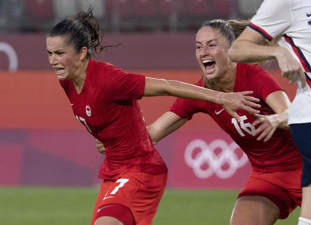 Canada midfielder Jessie Fleming (17) celebrates her game winning penalty kick goal with teammate Janine Beckie (16)  during a women's semifinal soccer match against United States at the 2020 Summer Olympics, Monday, August 2, 2021, in Kashima, Japan. (Photo by Frank Gunn/The Canadian Press via AP Photo)