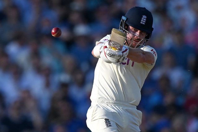 England's Rory Burns plays a shot during play on the fourth day of the fourth cricket Test match between England and India at the Oval cricket ground in London on September 5, 2021. (Photo by Glyn Kirk/AFP Photo via Getty Images)