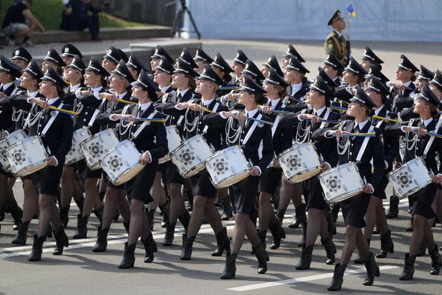 Ukrainian military drummers march along main Khreshchatyk Street during a military parade to celebrate Independence Day in Kyiv, Ukraine, Tuesday, August 24, 2021. (Photo by Efrem Lukatsky/AP Photo)