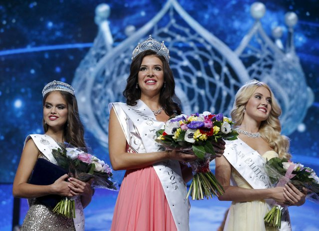 "First runner-up Vladislava Yevtushenko from Chita, Miss Russia 2015 Sofia Nikitchuk (C) from Yekaterinburg and second runner-up Anastasia Naydyonova from Voronezh pose for pictures after receiving their awards during the annual national ""Miss Russia"" beauty pageant at the Barvikha Luxury Village Concert Hall outside Moscow April 18, 2015. (Photo by Maxim Shemetov/Reuters)"