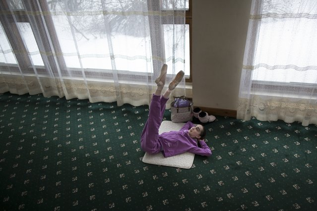 In this photo taken on Thursday, March  3, 2016, Harper Ortlieb, from Mount Hood, Oregon, stretches in a ballet class at the Bolshoi Ballet Academy in Moscow, Russia. (Photo by Alexander Zemlianichenko/AP Photo)