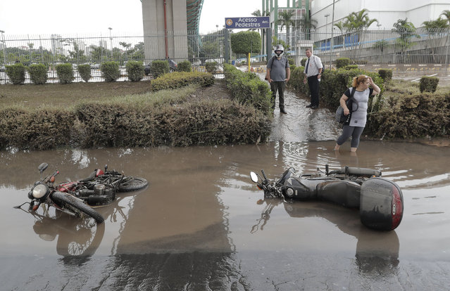 Destroyed motorcycles are left in a flooded street in Sao Paulo, Brazil, Monday, March 11, 2019. According to The Sao Paulo state fire department, heavy rains have caused the deaths of at least 11 people in and around Brazil's largest city, including a 1-year-old baby. (Photo by Andre Penner/AP Photo)