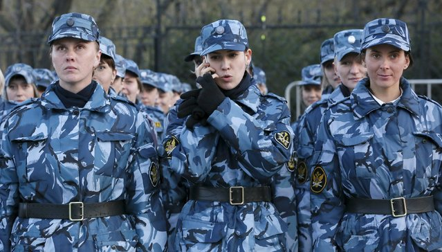 A servicewoman speaks on a mobile phone as she takes part in a rehearsal for the Victory Day festive ceremony in the Siberian city of Krasnoyarsk, Russia, April 29, 2015. (Photo by Ilya Naymushin/Reuters)