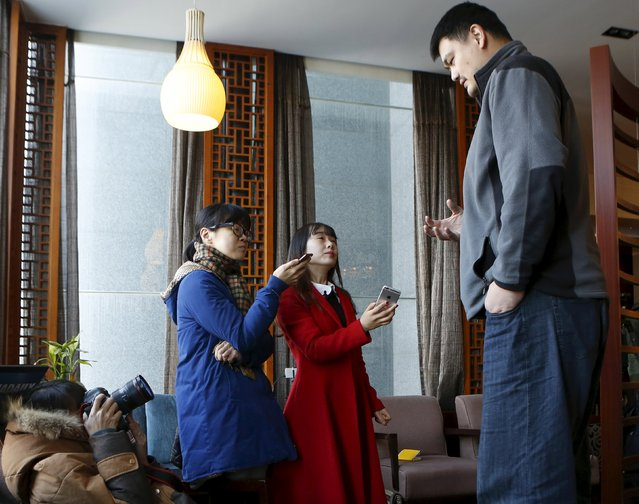 Former NBA player Yao Ming (R), a member of the 12th Chinese People's Political Consultative Conference (CPPCC) National Committee, is seen during an interview in Beijing, China, in this picture taken March 9, 2016. (Photo by Reuters/China Daily)