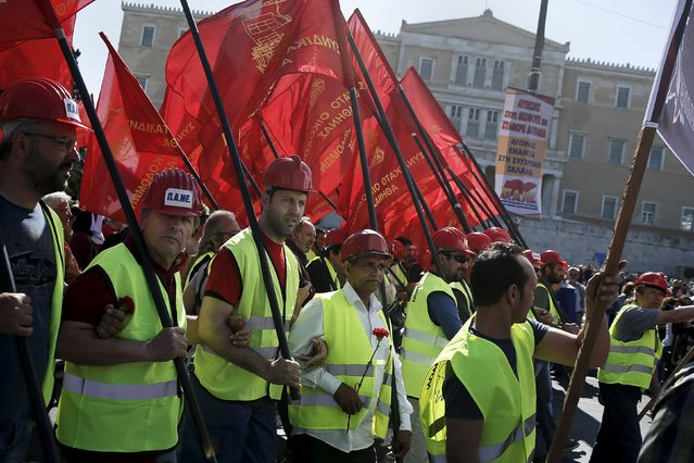 Protesters from the Communist-affiliated trade union PAME hold red flags during a May Day rally in front of the parliament building in Athens May 1, 2015. (Photo by Alkis Konstantinidis/Reuters)
