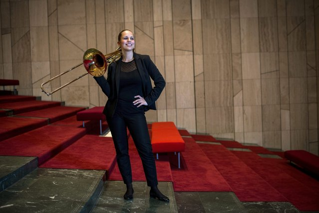 Trombonist Mariann Krasznai poses with her trombone before a Budapest Festival Orchestra concert at the concert hall of the Mupa cultural venue in Budapest, Hungary, 26 February 2016. (Photo by Bea Kallos/EPA)
