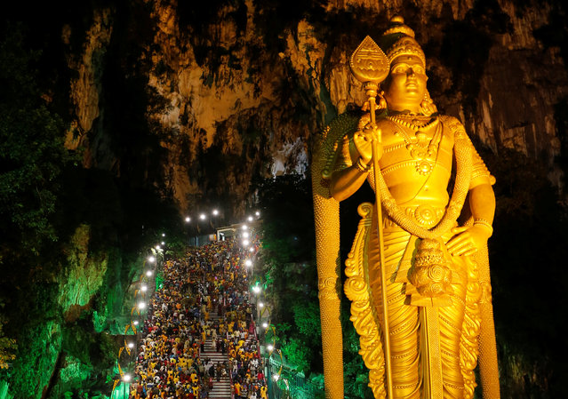 Devotees climb the steps to Batu Caves during the Hindu festival of Thaipusam in Kuala Lumpur, Malaysia February 9, 2017. (Photo by Lai Seng Sin/Reuters)