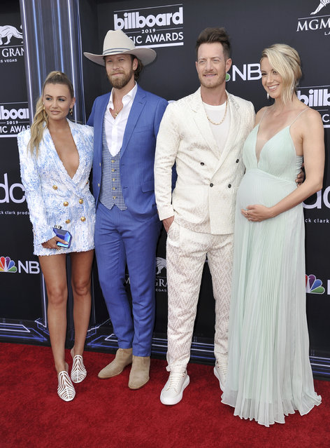 Brittney Marie Cole, from left, Brian Kelley and Tyler Hubbard, of Florida Georgia Line, and Hayley Stommel arrive at the Billboard Music Awards on Wednesday, May 1, 2019, at the MGM Grand Garden Arena in Las Vegas. (Photo by Richard Shotwell/Invision/AP Photo)