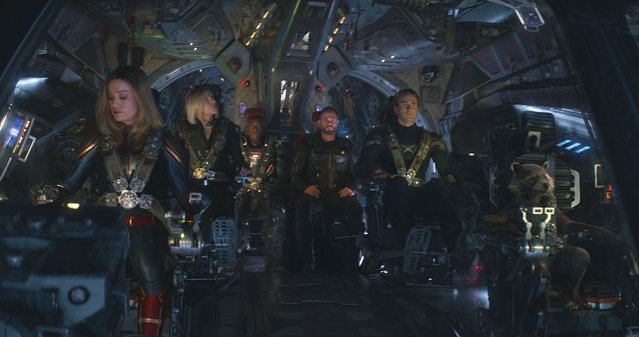 "This image released by Disney shows, from left, Brie Larson, Scarlett Johansson, Don Cheadle, Chris Hemsworth, Chris Evans and the character Rocket, voiced by Bradley Cooper, in a scene from ""Avengers: Endgame"". (Photo by Disney/Marvel Studios via AP Photo)"