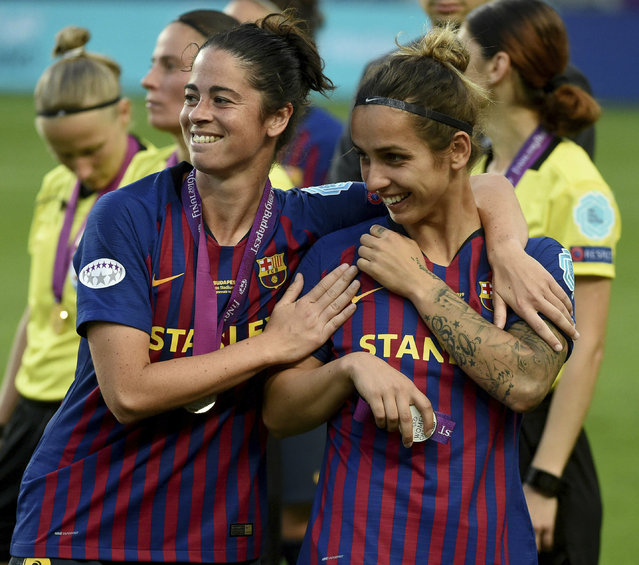 Marta Torrejon, left, and Natasha Andonova of Barcelona after their team lost to Olympique Lyon 4-1 in the women's soccer Champions League final match at the Groupama Arena in Budapest, Hungary, Saturday, May 18, 2019. (Photo by Balazs Czagany/MTI via AP Photo)