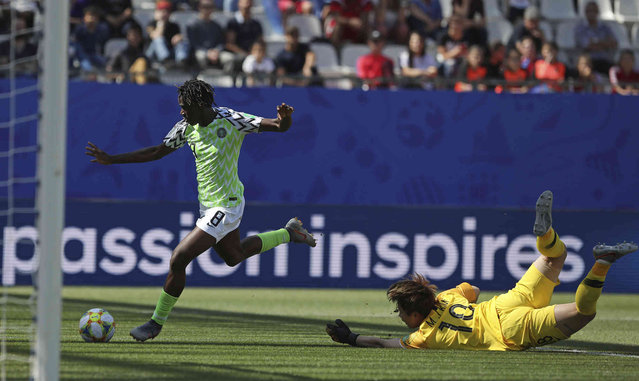 Nigeria's Asisat Oshoala takes the ball around South Korea goalkeeper Kim Min-jung on her way to scoring her side's second goal during the Women's World Cup Group A soccer match between Nigeria and South Korea in Grenoble, France, Wednesday June 12, 2019.(Photo by Laurent Cipriani/AP Photo)