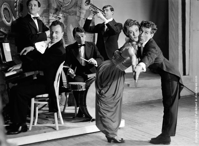 1956: Actors in the drama, 'For Amusement Only' during a band and dancing scene at the Apollo Theatre, London