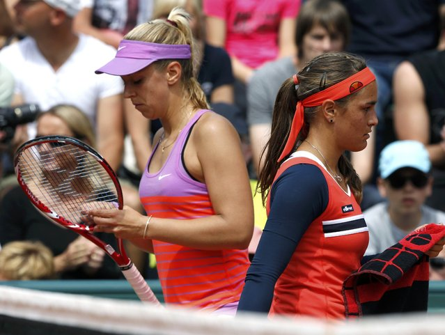Monica Puig (R) of Puerto Rico and Sabine Lisicki of Germany walk on the court during their women's singles match at the French Open tennis tournament at the Roland Garros stadium in Paris, France, May 25, 2015. (Photo by Pascal Rossignol/Reuters)