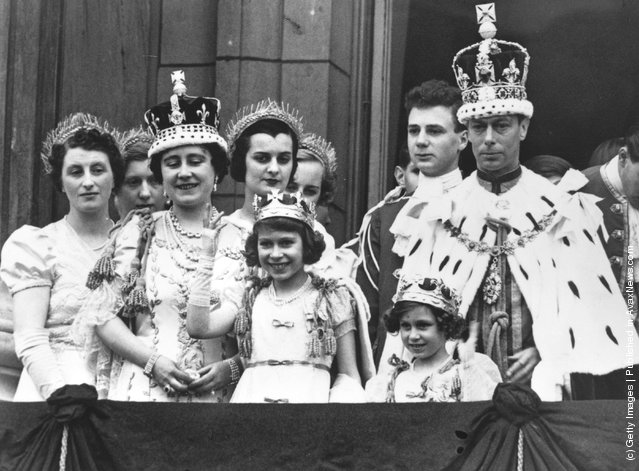 1937: King George and Queen Elizabeth with Princesses Elizabeth (centre) and Margaret and members of the extended Royal Family in full Coronation regalia on the balcony of Buckingham Palace after their Coronation ceremony