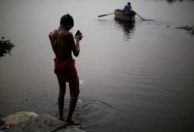A man bathes in the waters of river Yamuna during a hot summer day in the old quarter of Delhi, India, April 19, 2016. (Photo by Adnan Abidi/Reuters)