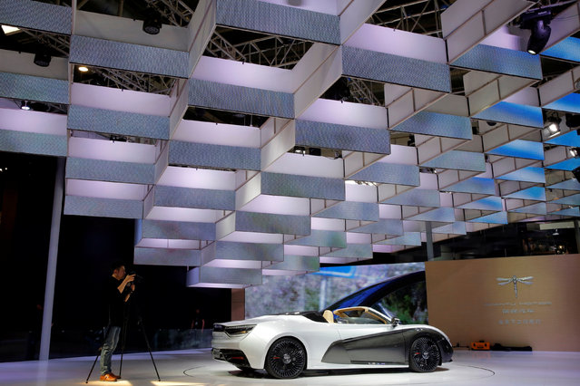A man takes a picture of a Qiantu motor's K50 during the Auto China 2016 show in Beijing, China April 25, 2016. (Photo by Kim Kyung-Hoon/Reuters)