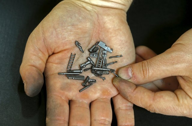 Jadranko Djordjevic, a self-taught artist, shows his miniature sculptures on graphite pencils in Tuzla, Bosnia and Herzegovina April 26, 2016. (Photo by Dado Ruvic/Reuters)