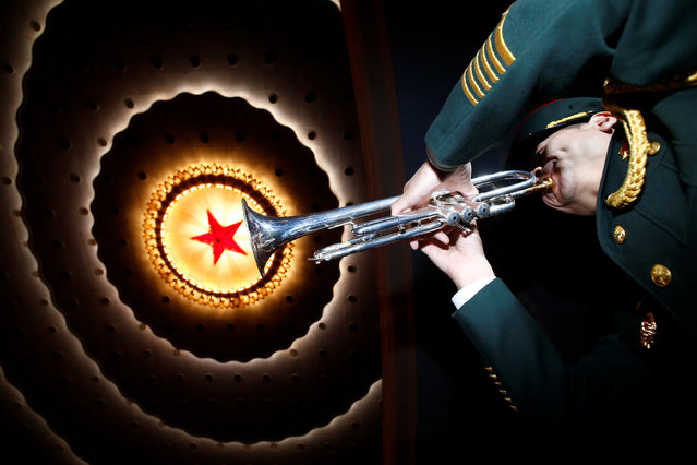 A military band member prepares ahead of the closing session of China's National People's Congress (NPC) at the Great Hall of the People in Beijing, China, March 15, 2017. (Photo by Thomas Peter/Reuters)