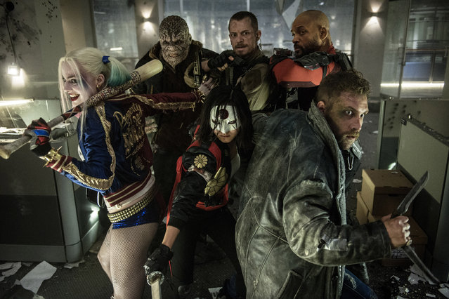"""This image released by Warner Bros. Entertainment shows, from left, Margot Robbie, Adewale Akinnuoye-Agbaje, Karen Fukuhara, foreground center, Joel Kinnaman, Will Smith and Jao Courtney, foreground right, in a scene from """"Suicide Squad"""", opening nationwide on August 5, 2016. (Photo by Clay Enos/Warner Bros. Entertainment via AP Photo)"""