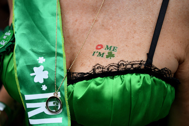 A participant poses for a photo during celebrations of St. Patrick's Day at a hotel in The Rocks in Sydney, Australia, 17 March 2017. St. Patrick's Day is marked annually on 17 March to commemorate Saint Patrick, a patron saint of Ireland. (Photo by Dan Himbrechts/EPA)