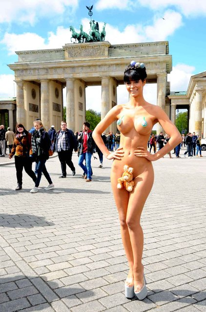 Model Micaela Schaefer poses with a toy rabbit and Easter eggs during a Easter photocall in front of the Brandenburg Gate on April 16, 2014 in Berlin, Germany. (Photo by Patrick Hoffmann/WENN/SIPA Press)