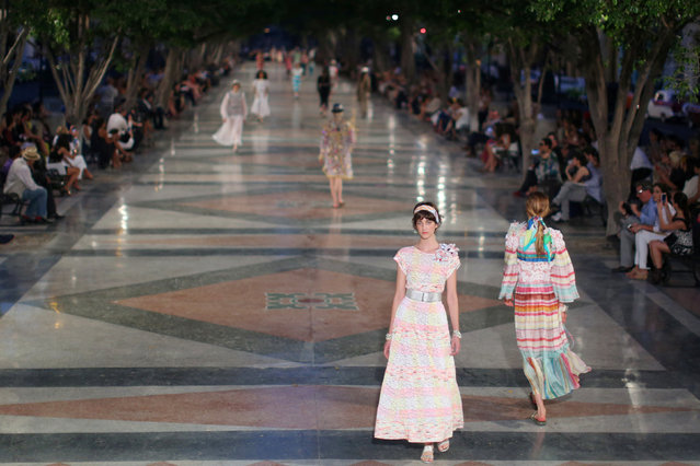 Models present creations by German designer Karl Lagerfeld as part of his latest inter-seasonal Cruise collection for fashion house Chanel at the Paseo del Prado street in Havana, Cuba, May 3, 2016. (Photo by Alexandre Meneghini/Reuters)