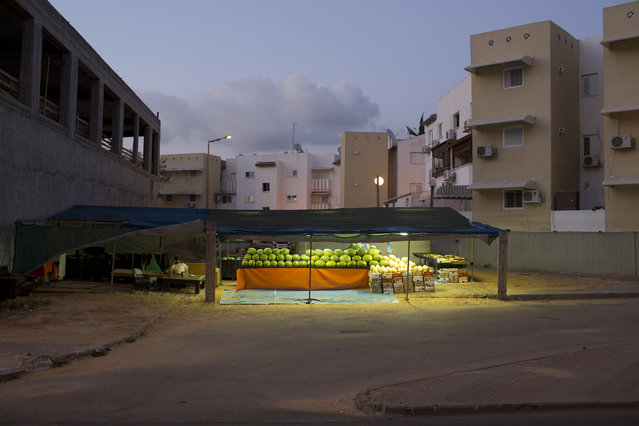 In this Tuesday, June 23, 2015, photo, an Israeli vendor waits for clients at the southern Israeli town of Sderot, next to the Israel-Gaza border. (Photo by Oded Balilty/AP Photo)