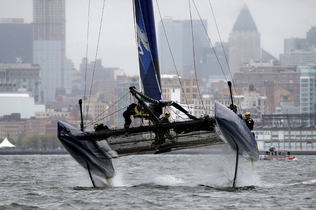 AC45F racing sailboat Artemis Racing comes out of the water as they make a turn during practice racing ahead of the America's Cup World Series sailing event in New York, May 6, 2016. (Photo by Mike Segar/Reuters)