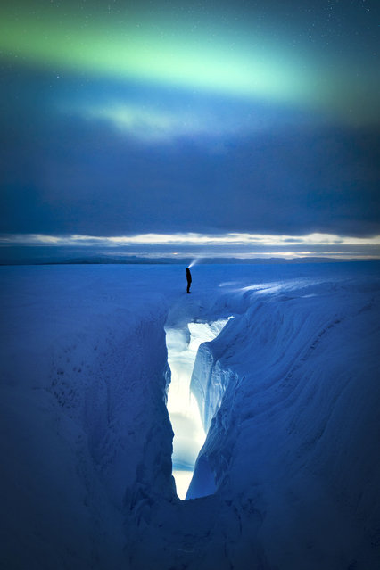 Ice crevasse and aurora, Greenland. (Photo by Paul Zizka/Caters News Agency)
