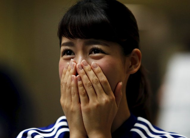 A soccer fan of Japan reacts during their FIFA Women's World Cup semi-final soccer match against England, at a public viewing event in Tokyo, Japan, July 2, 2015. (Photo by Yuya Shino/Reuters)