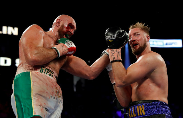 Tyson Fury, left, of England, punches Otto Wallin, of Sweden, during their heavyweight boxing match Saturday, September 14, 2019, in Las Vegas. Fury won by unanimous decision. (Photo by Steve Marcus/Reuters)