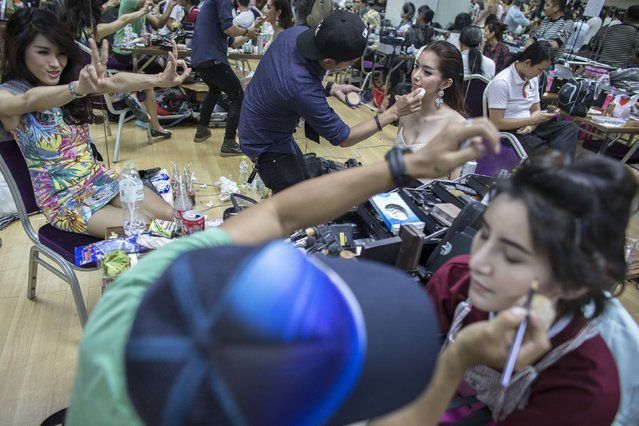 Contestants get ready backstage. (Photo by Athit Perawongmetha/Reuters)