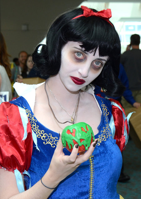 A fan dressed as Snow White attends day 1 of Comic-Con International on Thursday, July 9, 2015, in San Diego, Calif. (Photo by Tonya Wise/Invision/AP Photo)