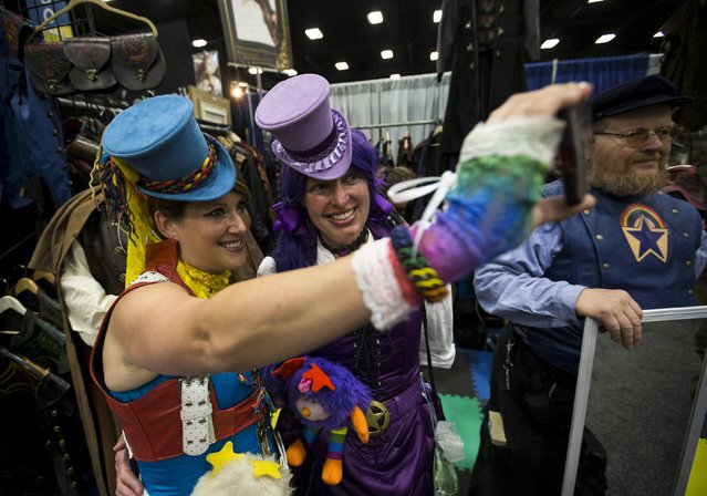 """Cosplay enthusiasts Stacey Allen (L) and Laura Guiney, dressed as steampunk versions of """"Rainbow Brite"""", take a selfie during the 2015 Comic-Con International Convention in San Diego, California July 10, 2015. (Photo by Mario Anzuoni/Reuters)"""